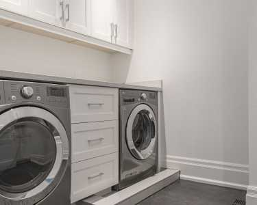 Custom designed laundry room by Black Pearl