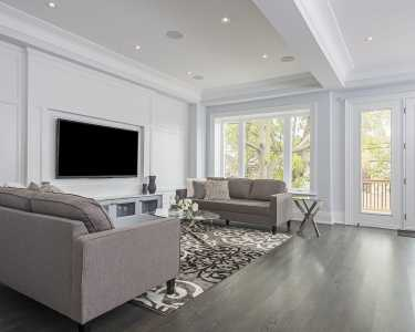 Custom home living room with large windows Black Pearl
