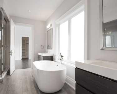 Black pearl custom home bathroom with luxury bath