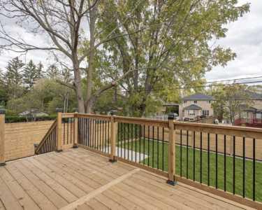 Custom home wooden deck Black Pearl