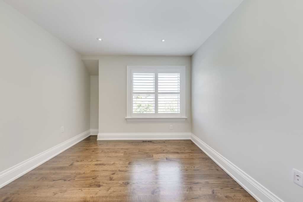 custom home bedroom with a large window north york