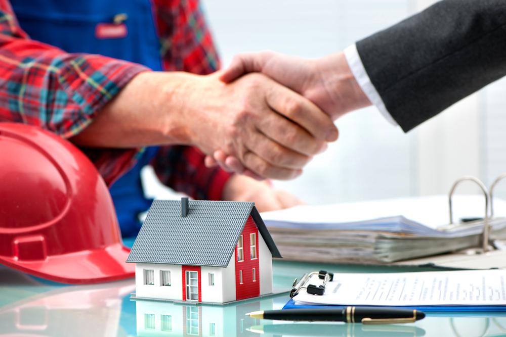 photo of two people shaking hands on house deal