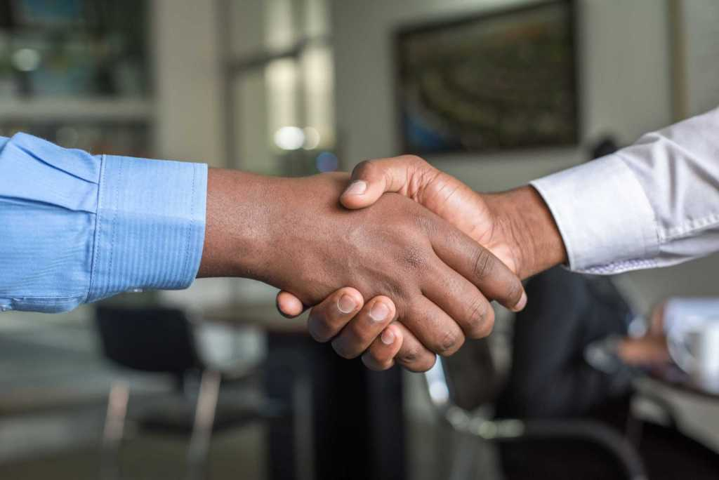 two people shaking hand on a deal