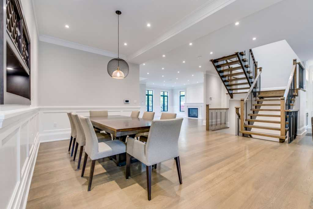 open space dining room with coffered wall decor - home renovation toronto