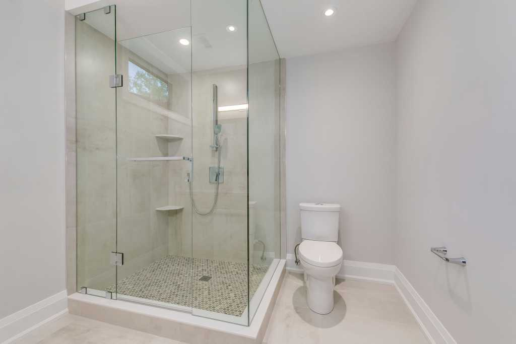 small bathroom with walk in shower and toilet - renovation toronto