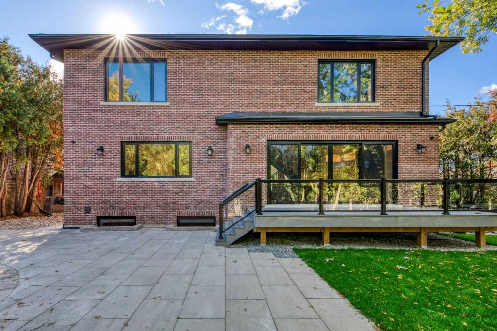 custom home with luxury backyard and deck - toronto home builders