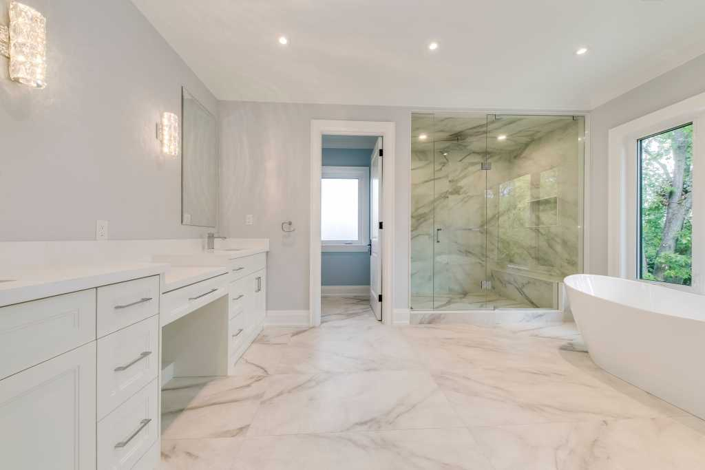 modern bathroom with marble floor tiles and walk in shower - custom home builder toronto