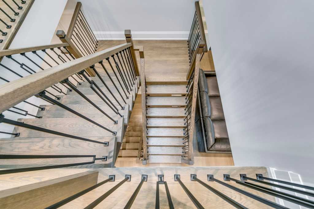 modern staircase with steel railings and wooden stairs