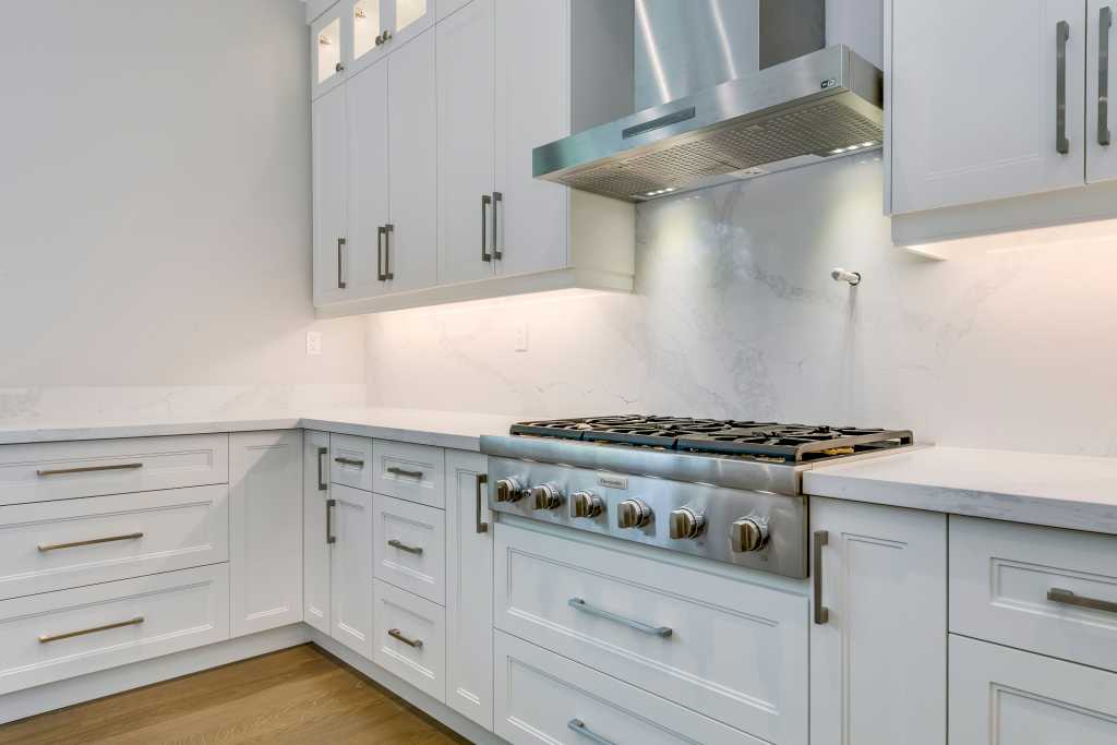 custom homes toronto - amazing kitchen with backlit cabinets and wooden floor