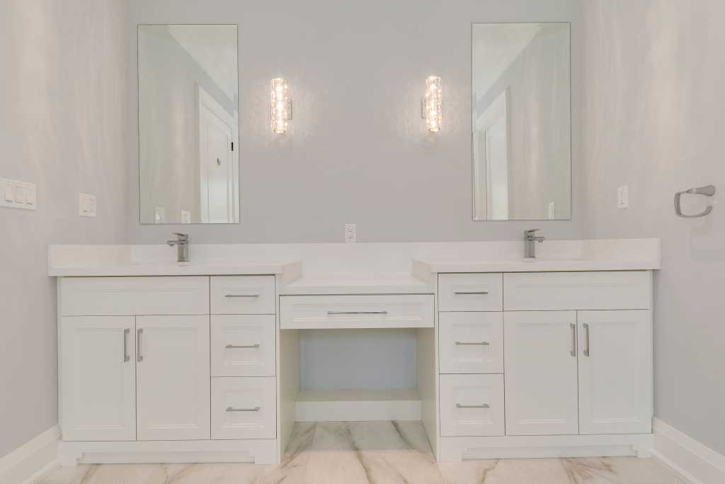 double wall mirror and custom white vanity in amazing bathroom by black pearl custom homes