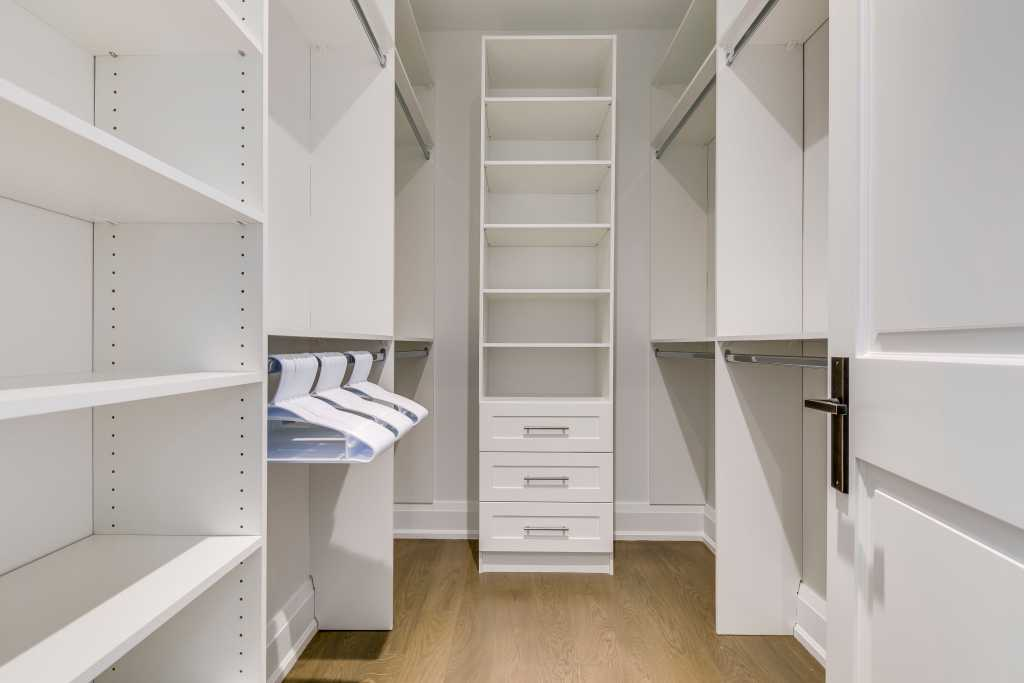 build in closet with cabinets and shelves - home renovations mississauga