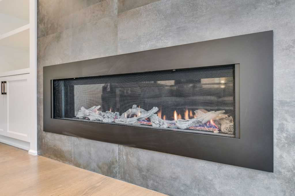build in fireplace in custom marble wall decor by black pearl