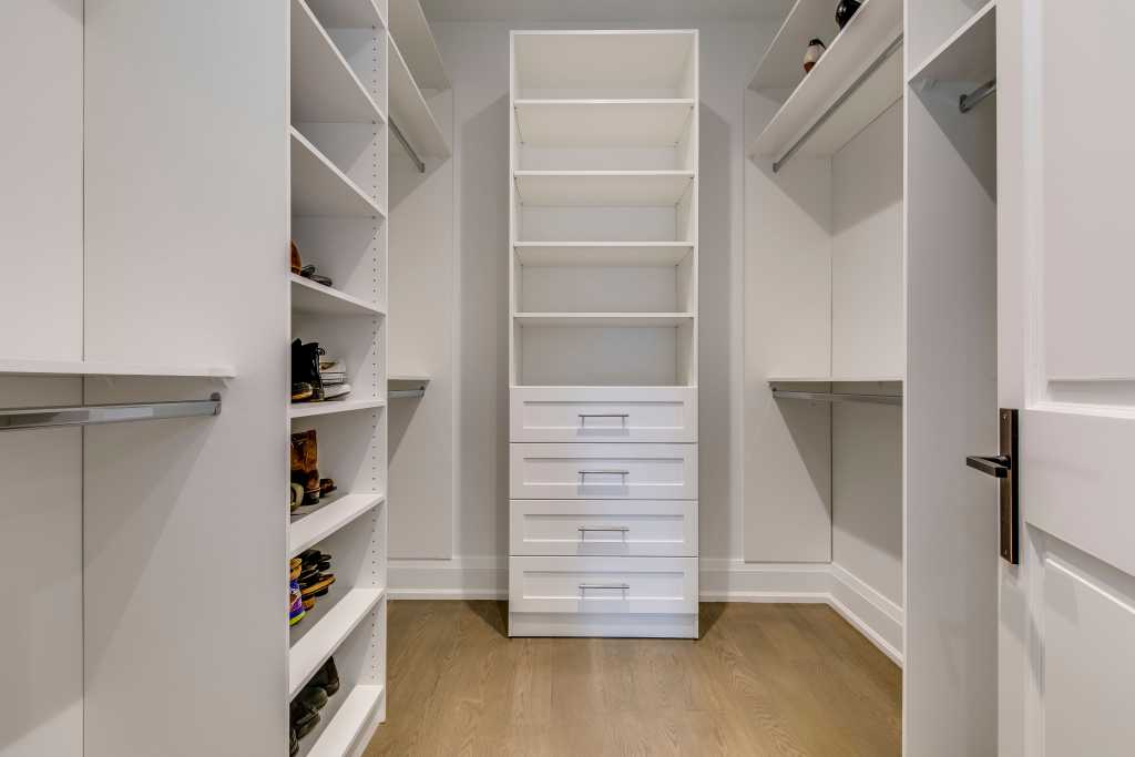 changing room with build in shalves and cabinets