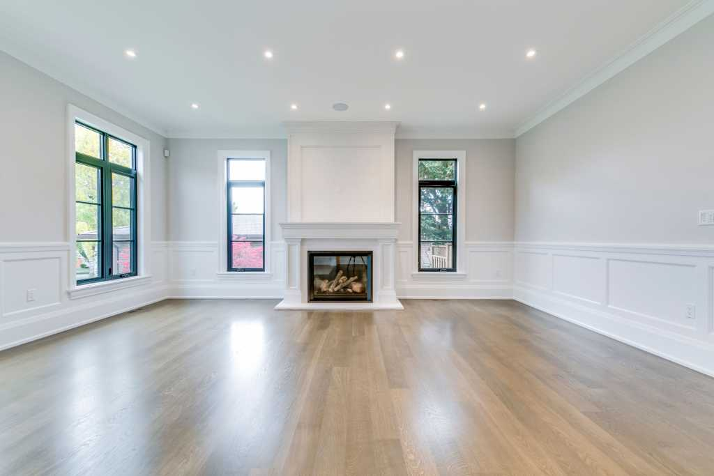 classic family room with build in fireplace and crown moulding