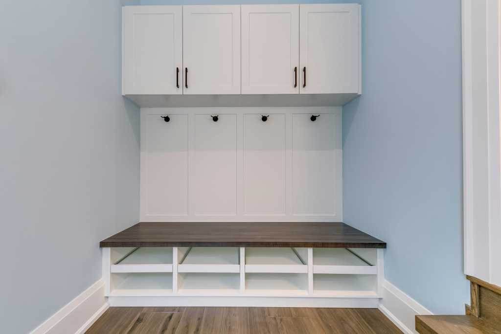 custom locker room with build in closet and shoes shelves