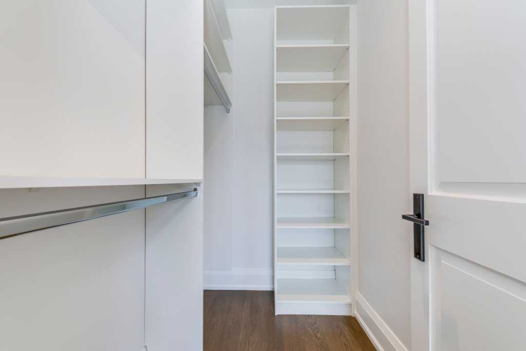 custom changing room with build in storage space - custom home builders toronto