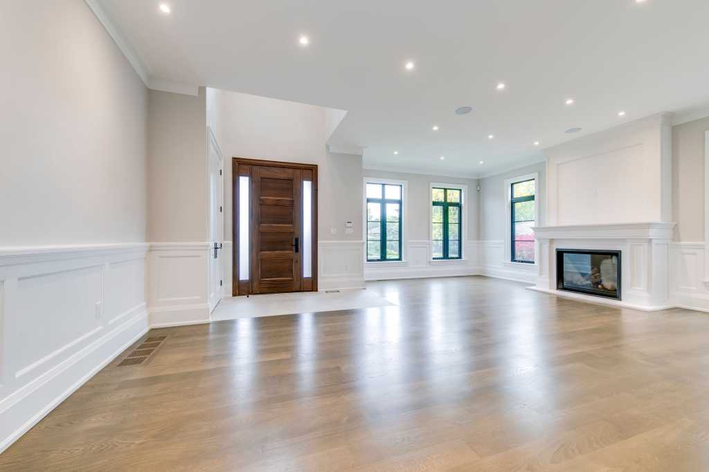modern custom home with build in fireplace and wainscoting wall trim