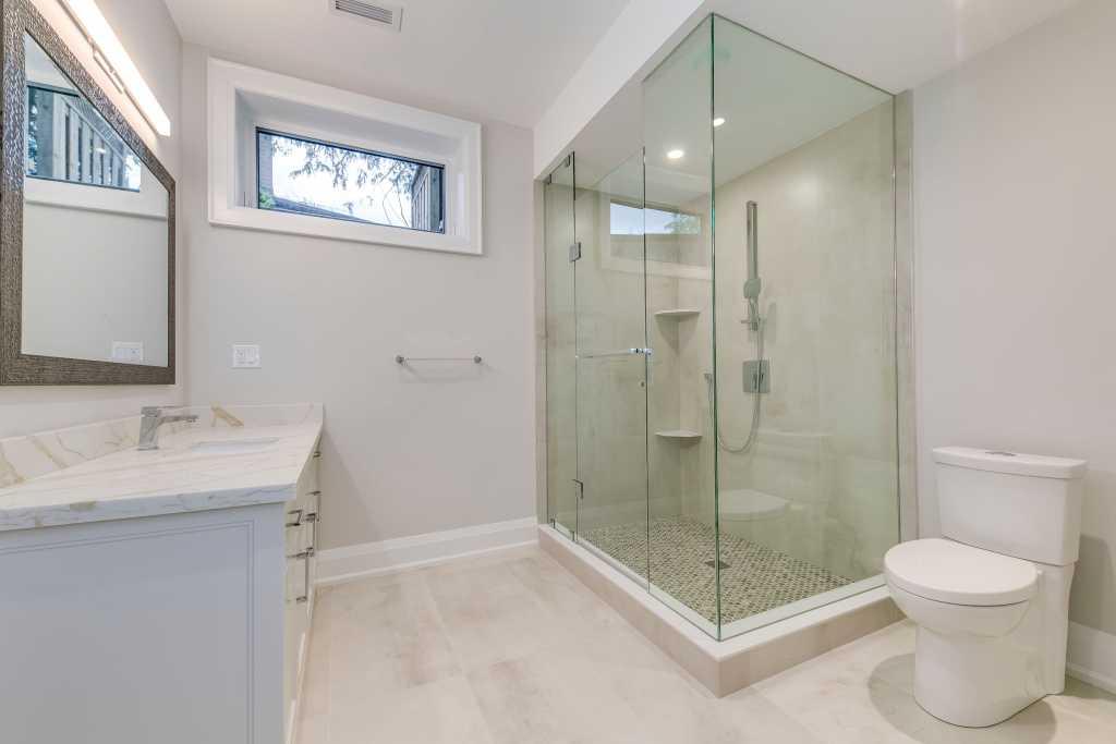 modern bathroom with walk in shower - home builders gta