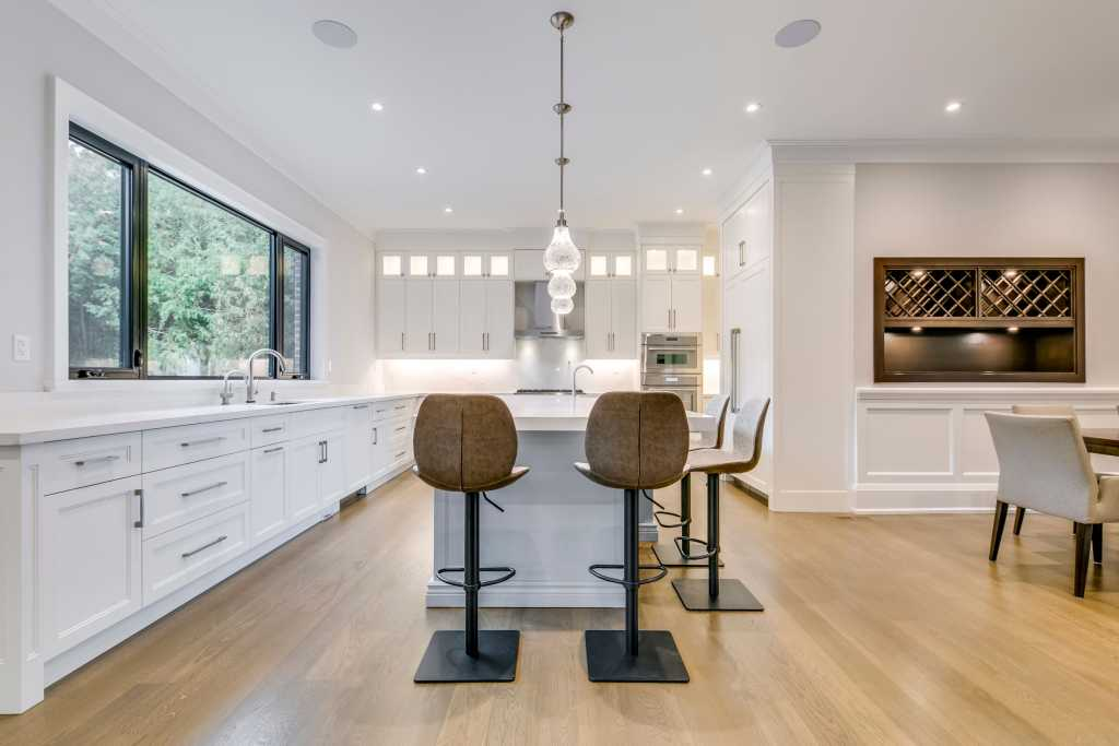 luxury dining room and kitchen in amazing custom home - design your dream house
