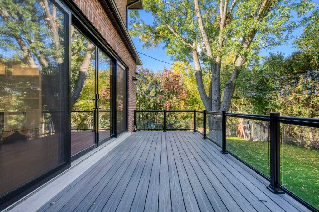 modern home with custom deck and luxury backyard landscaping - exterior home design by black pearl