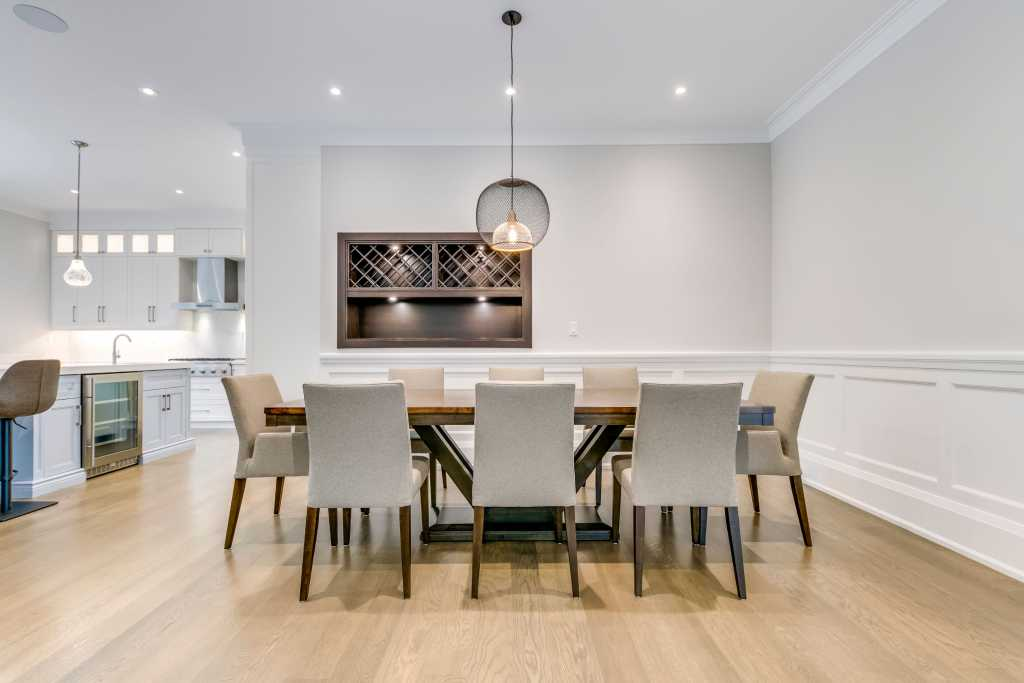 custom home with luxury kiitchen and dining room build by black pearl custom homes