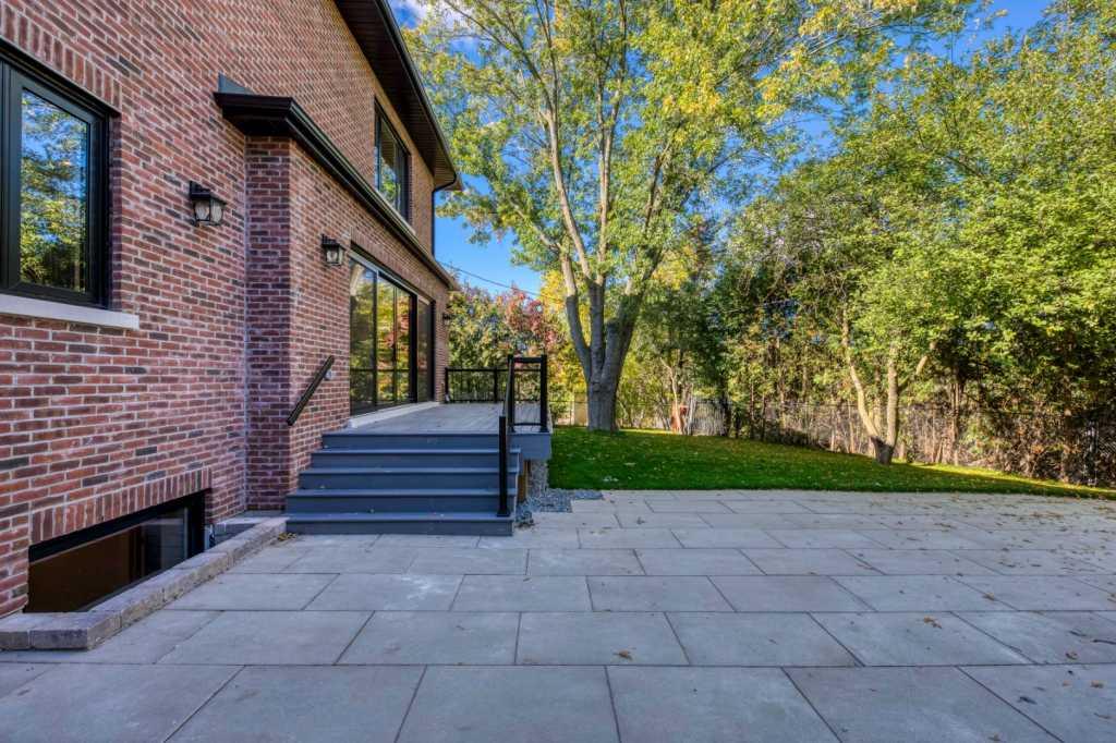amazing backyard with interlocking and custom deck - home renovations mississauga