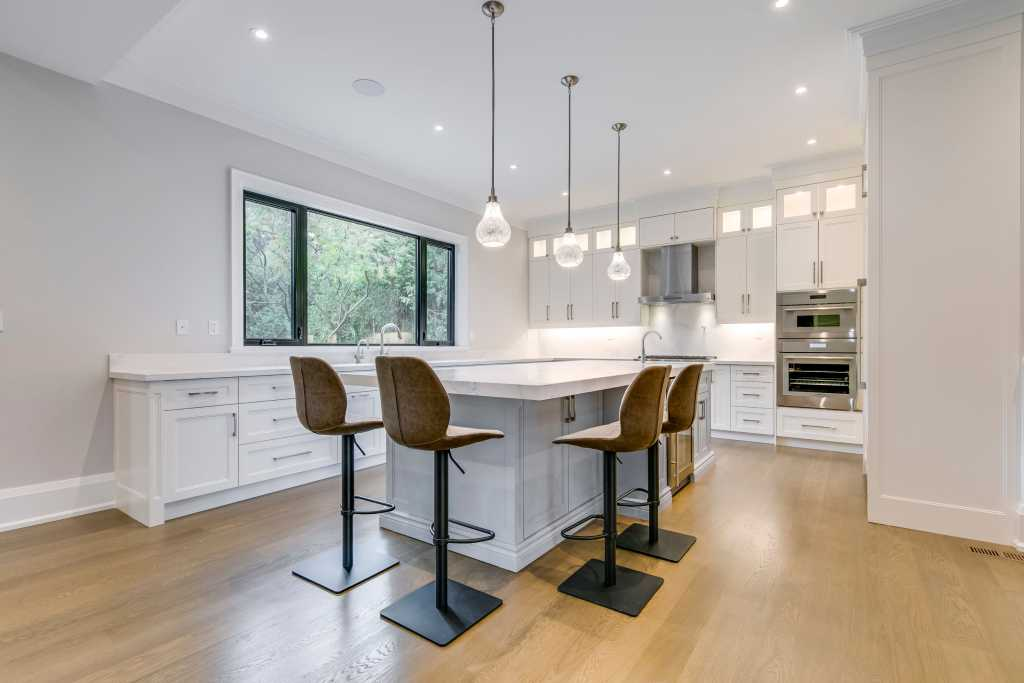 custom kitchen with white cabinets and crown moulding