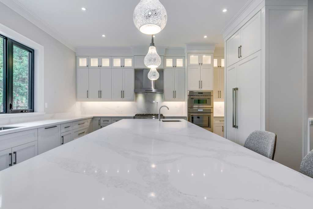 marble island counter top in amazing kitchen