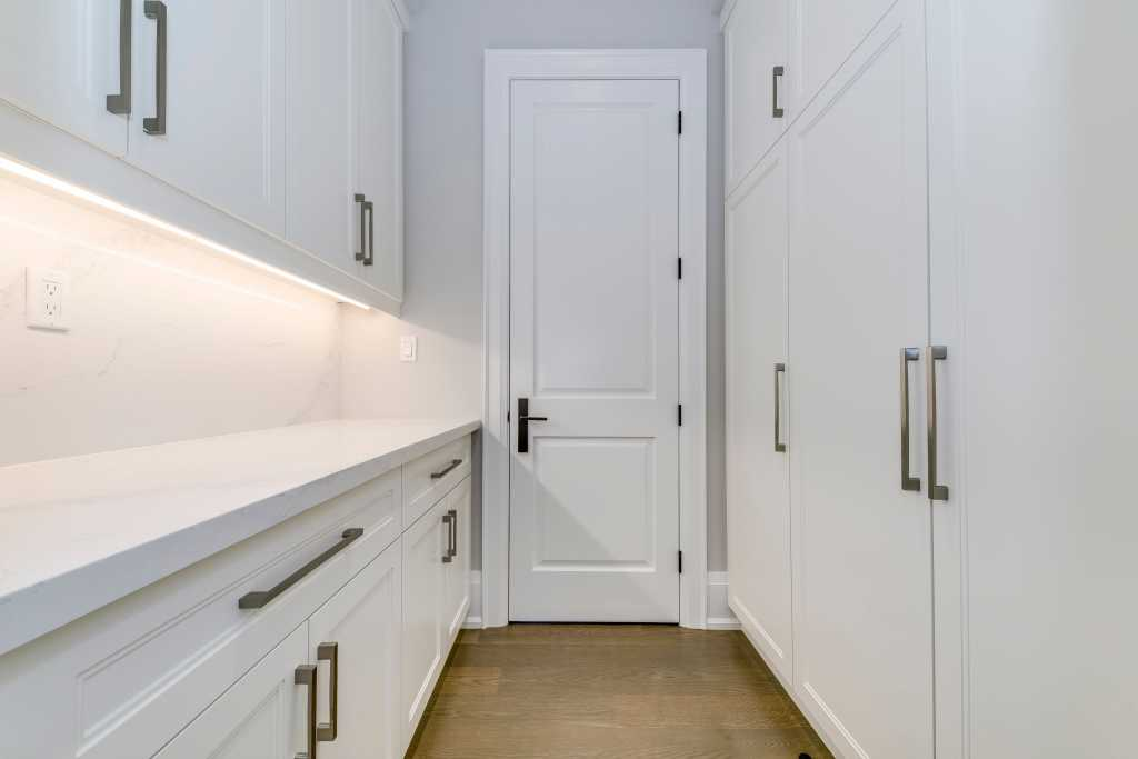 luxury closet room with marble counter top and huge cabinets