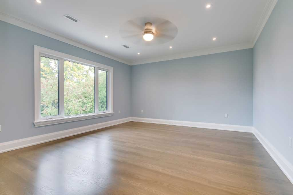 amazing home bedroom with baseboard trim and crown moulding - home renovations mississauga