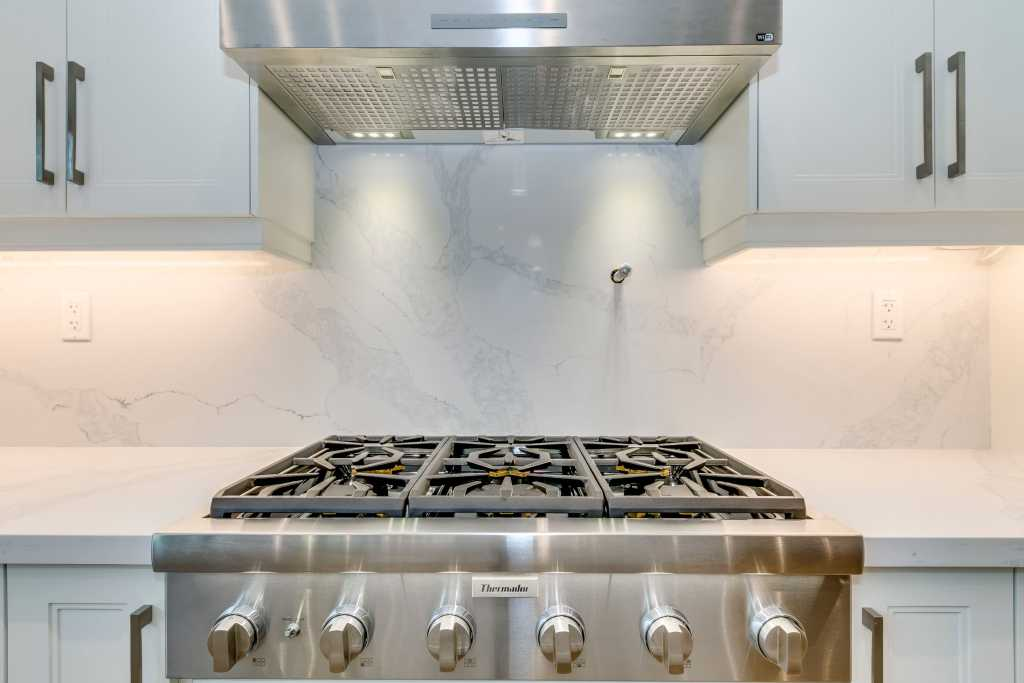 build in gas stove in amazing custom kitchen by black pearl custom homes