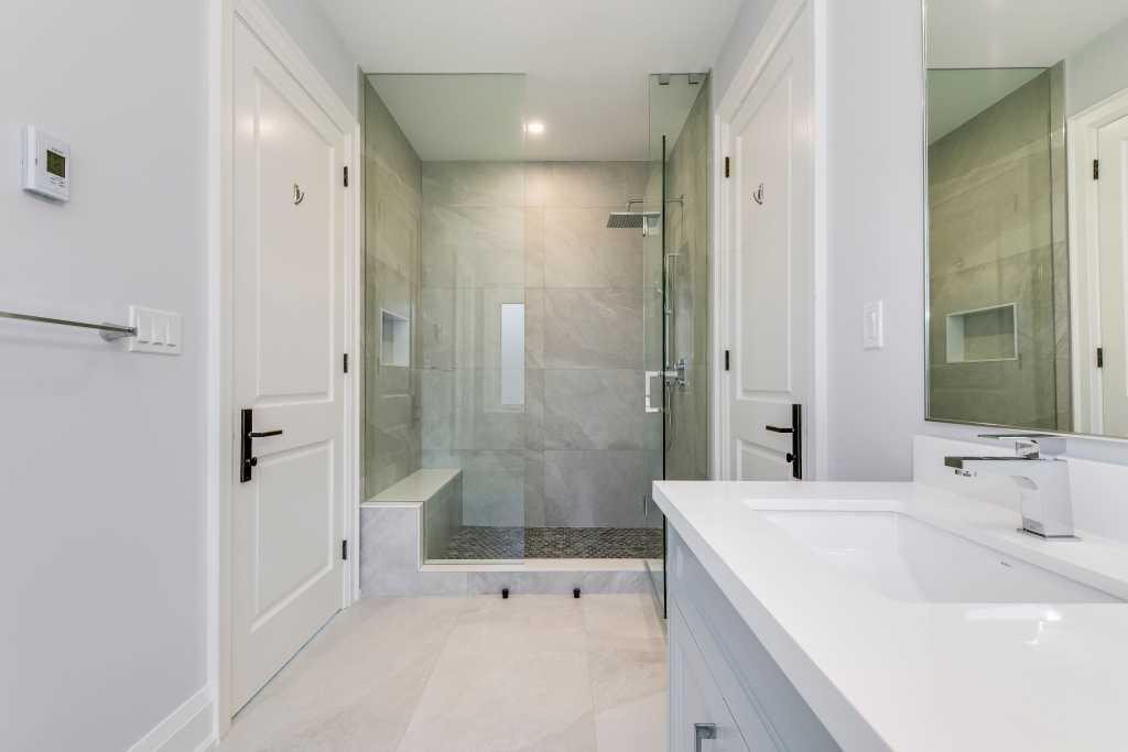 walk in shower in custom bathroom build by black pearl custom home