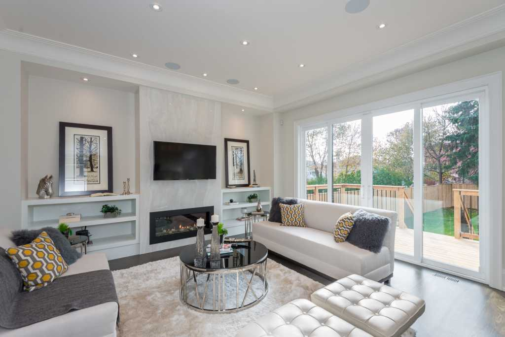 Modern Family Room with Build in Fireplace - Home Renovation Services Mississauga