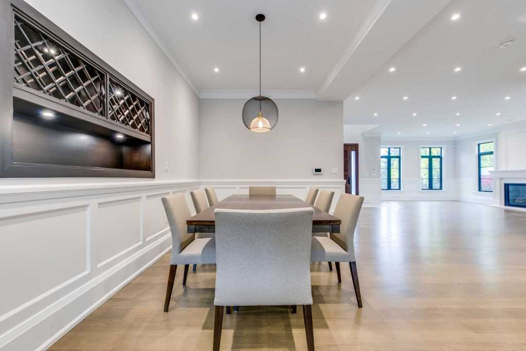 Custom Dining Room with Coffered Wall Decor - Custom Homes by Black Pearl Etobicoke