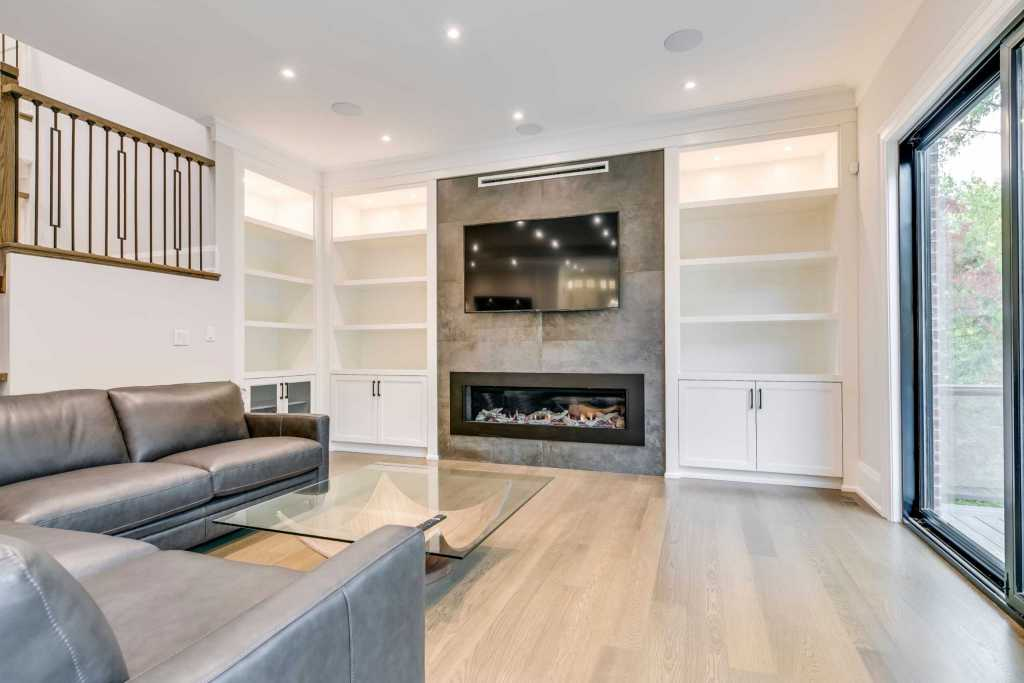 Modern Family Room with Custom Fireplace - Complete Home Renovation Project Oakville