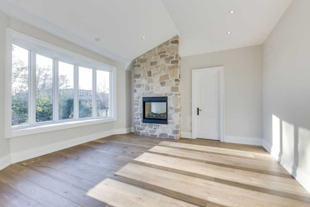 Amazing Family Room with Build in Fireplace - Custom Homes by Black Pearl Oakville